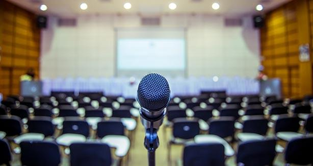 Microphone in front of empty auditorium